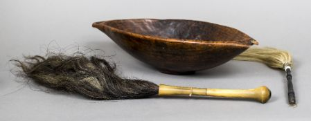 An African treen bowl Of twin handled rounded navette form;