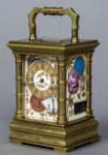A 19th century lacquered brass cased miniature carriage clock With turned faux bamboo columns