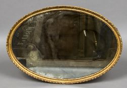 A 19th century gilt wall glass Of oval form. 82 cm high.