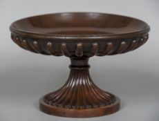 A turned and carved mahogany tazza The fluted shallow bowl supported on the reeded spreading column