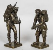 A pair of 19th century Continental patinated bronze models of pedlars Each modelled standing