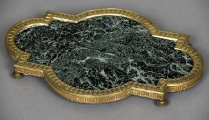 A French Empire ormolu mounted green variegated marble plateau Of shaped rectangular form with