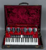 A Scandalli piano accordion Of typical form, in mottled red casing,