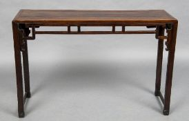 A 19th century Chinese hardwood altar table The cleated rectangular top above the carved pierced