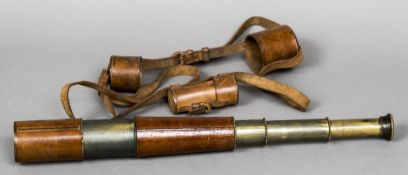 A First World War officers leather cased four draw telescope by R & J Beck Limited, London,