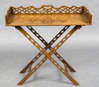 A mahogany butlers tray With three quarter pierced gallery and carrying handles,
