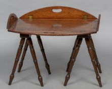 A 19th century mahogany folding butler's tray Of typical oval panelled form with brass hinges,