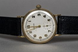 A 1940s 9 ct gold gentleman's wristwatch by Marvin The circular dial with Arabic numerals and
