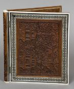 A 19th century Anglo-Indian carved sandalwood and Sadeli ware blotter Of double hinged form,
