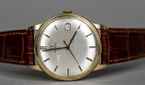 A 9 ct gold cased Omega gentleman's wristwatch The signed silvered dial with gilt baton markers and