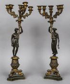 A pair of Empire patinated bronze candelabra Each with six branches above the figural stems,