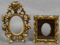 A carved giltwood Florentine frame Worked with acanthus scrolls; together with another.