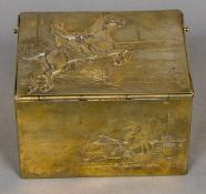 A 19th century gilt metal tobacco box The hinged cover cast with a steeplechaser enclosing a