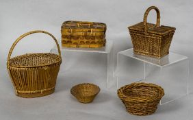 A miniature wicker picnic basket Together with another lidded basket,