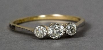 An 18 ct gold and platinum three stone diamond ring CONDITION REPORTS: Generally in