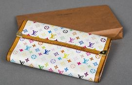 A Louis Vuitton multicoloured monogrammed purse Housed in a Louis Vuitton paper sleeve. 19.