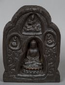 An antique Tibetan carved wooden shrine Of standing lappet form carved with four views of Buddha.
