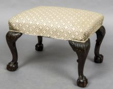 A 19th century stool The overstuffed top,