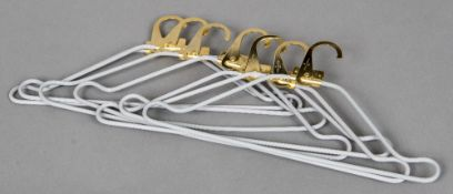 Seven Louis Vuitton coat hangers Each folding top inscribed R Louis Vuitton Paris. Each 42 cm wide.