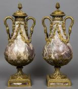 A pair of 19th century Continental ormolu mounted variegated marble twin handled urns and