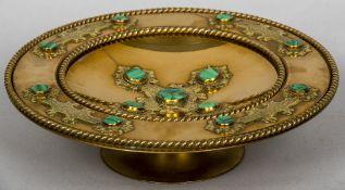 A Victorian gilt metal malachite set tazza With engraved strapwork. 33 cm diameter.