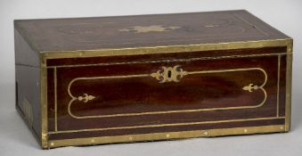 A Regency brass bound mahogany writing slope Of typical hinged form with brass inlaid decoration,