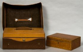 A leather case by J G Vickery, London With Bramah lock, carrying handle and outer canvas sleeve,
