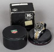 A boxed Tag Heuer gentleman's wristwatch The dial inscribed Professional 200 Metres,