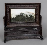 A 19th century Chinese pale and green hardstone inset carved and pierced hardwood table screen The