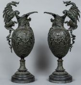 A pair of 19th century bronze ewers Each extensively cast with scrolling acanthus and mythical