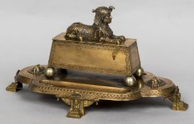A late 19th century Egyptian Revival bronze desk stand The lobed main body mounted with a casket