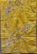 A 19th century Chinese embroidered silk panel The yellow ground decorated with phoenix and flaming