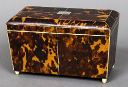 A 19th century tortoiseshell tea caddy The domed hinged rectangular top including two lidded