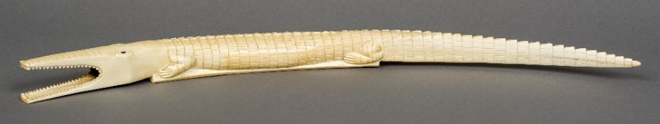 A large early 20th century African carved ivory crocodile Typically worked. 71.5 cm long.