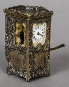 A 19th century Continental silver gilt miniature desk timepiece Formed as a Sedan chair,