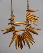 """A tribal """"tooth"""" necklace Each of varying sizes, the longest approximately 11 cm."""