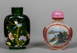 A Chinese enamel decorated green glass snuff bottle Decorated with birds amongst a floral landscape;