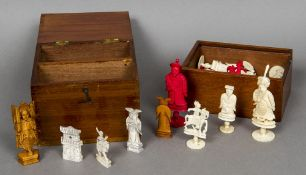 Two 19th century Chinese carved ivory figural chess sets One red and white,