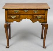 An 18th century walnut and fruitwood lowboy The moulded rounded rectangular top above one long and