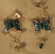 A pair of silver butterfly earrings