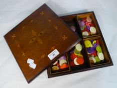 An inlaid bridge box and counters within