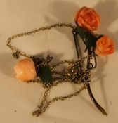 A stained coral brooch and necklace pendant en-suite
