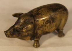 A brass vesta formed as a pig