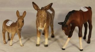 Two Beswick donkeys and a matt Beswick foal