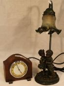 A lamp and an oak mantle clock