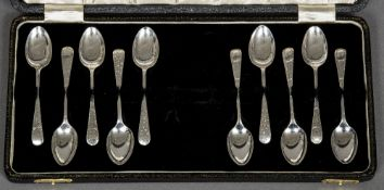 A matched set of ten silver coffee spoons, hallmarked Sheffield 1899 and 1921,