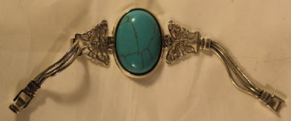 A silver and turquoise bracelet