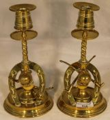 A pair of Victorian brass candlesticks each mounted with equestrian motifs