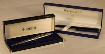 A boxed Parker pen and another boxed pen