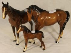 Two Beswick horses and a foal